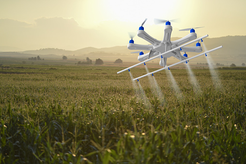 Insecticide「Drone spraying a field in sunset」:スマホ壁紙(13)