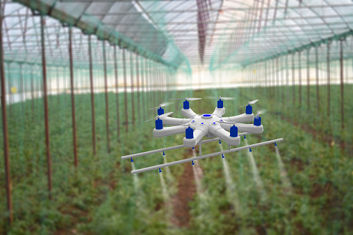 Spraying「Drone spraying a field in greenhouse」:スマホ壁紙(3)