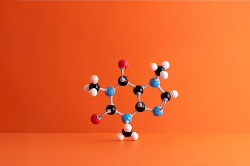 Chemical「Caffeine formula's molecular structure over orange background」:スマホ壁紙(13)