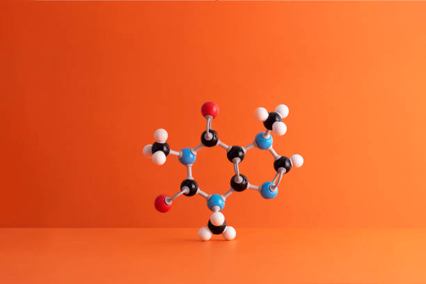 Caffeine formula's molecular structure over orange background:スマホ壁紙(壁紙.com)