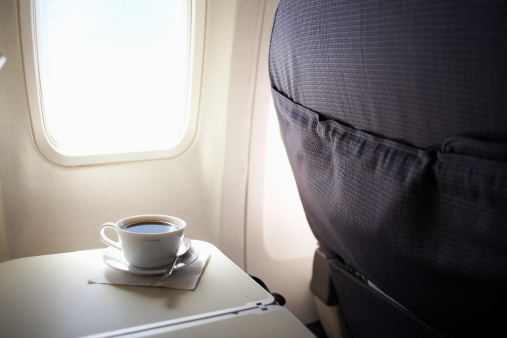 Airplane Seat「Cup of coffee on airplane tray table by window, elevated view」:スマホ壁紙(19)