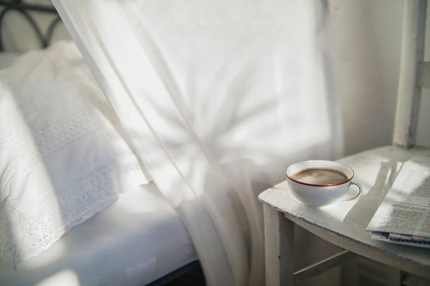 Cup of coffee and newspaper on an old chair at bedroom:スマホ壁紙(壁紙.com)