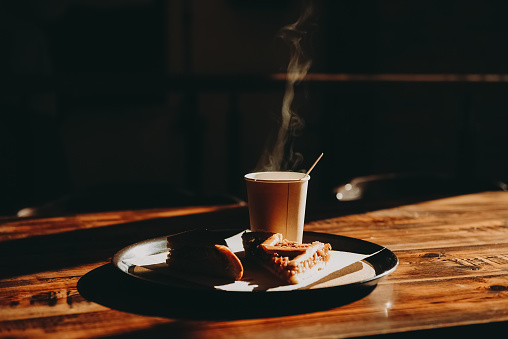 Sweet Food「Cup of coffee and cake on a tray in the sunlight」:スマホ壁紙(10)