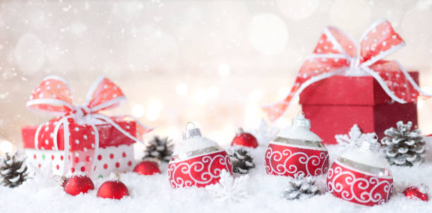 Christmas holiday whimsical baubles and gifts on a festive wintery background:スマホ壁紙(壁紙.com)