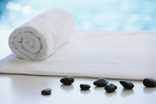 Spa「Rolled up towel and stones on massage table」:スマホ壁紙(5)