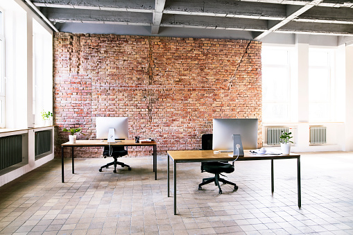 Abandoned「Coworking space with brick wall in office」:スマホ壁紙(7)