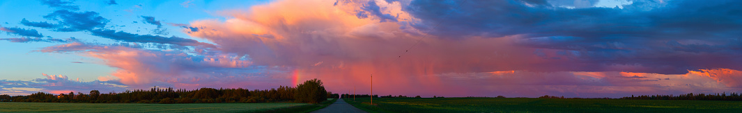 cloud「Glowing pink clouds over green fields and a country road at sunset」:スマホ壁紙(18)