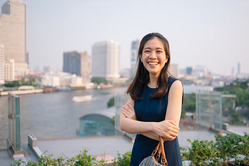 Young Women「Asian smile at camera with scenics  Cityscape view from Iconsiam is one of the largest shopping malls in Asia on Chao Phraya River bangkok in Thailand」:スマホ壁紙(6)