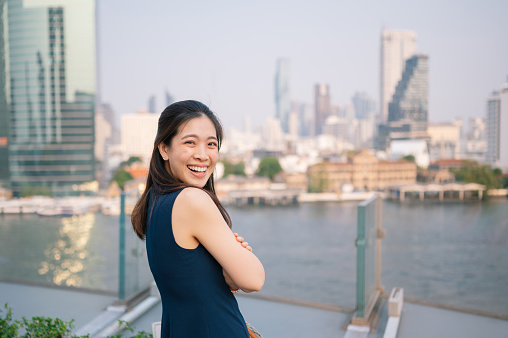 Young Women「Asian smile at camera with scenics  Cityscape view from Iconsiam is one of the largest shopping malls in Asia on Chao Phraya River bangkok in Thailand」:スマホ壁紙(5)