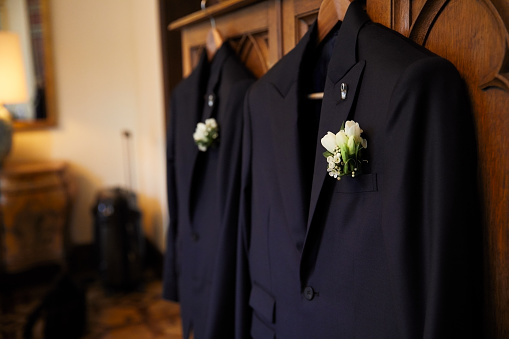 Married「Pair of suits hanging ready for the wedding.」:スマホ壁紙(5)