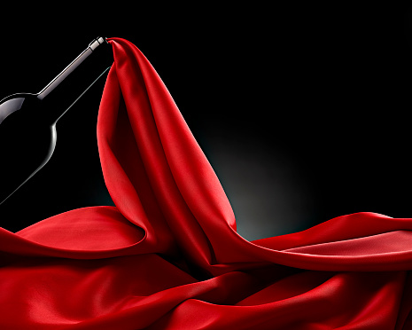 絹「Wine bottle and flowing red silk in front of black background」:スマホ壁紙(19)