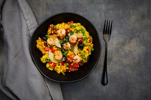 Paella「Paella with rice, bell pepper, tomato, artichoke, pea, black olive, curcuma and shrimps」:スマホ壁紙(9)