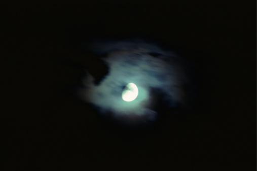 月「A full moon emerging from behind clouds」:スマホ壁紙(1)
