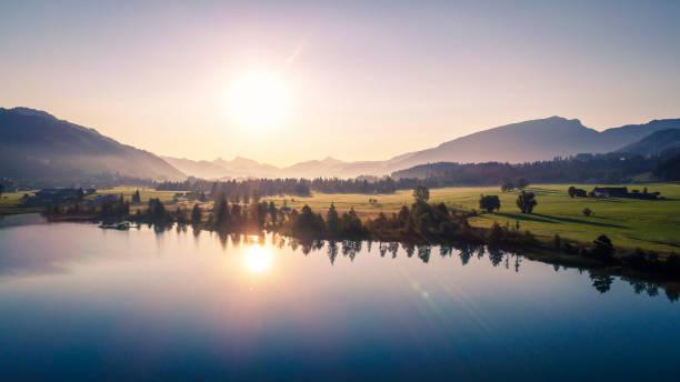 Austria, Tyrol, Kaiserwinkl, Aerial view of lake Walchsee at sunrise:スマホ壁紙(壁紙.com)