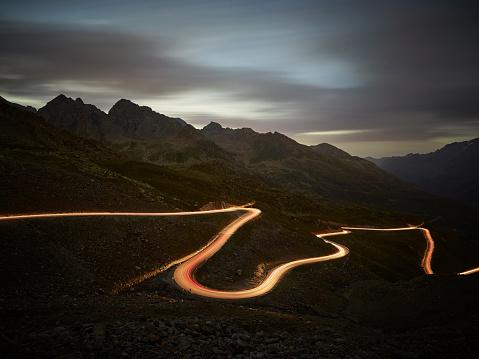 Ötztal Alps「Austria, Tyrol, Kaunertal, road in the evening, light trails」:スマホ壁紙(3)