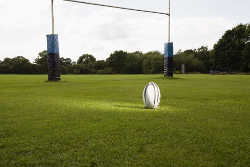 Goal Post「An illuminated rugby ball on a rugby pitch」:スマホ壁紙(4)