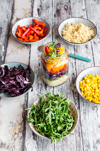 Bulgur Wheat「Glass of rainbow salad with bulgur, rocket and different vegetables and bowls with ingredients」:スマホ壁紙(13)