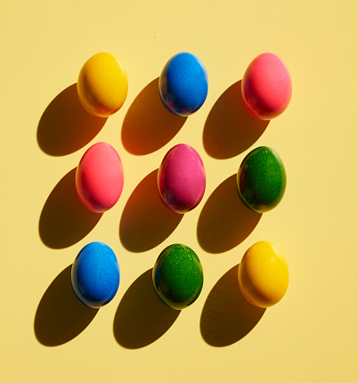 Easter「Dyed Easter eggs on yellow background」:スマホ壁紙(14)