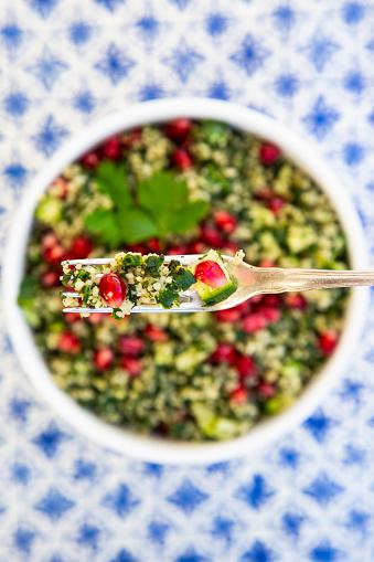 Bulgur Wheat「Bulgur herbs tabbouleh with pomegranate seeds on fork, close-up」:スマホ壁紙(19)