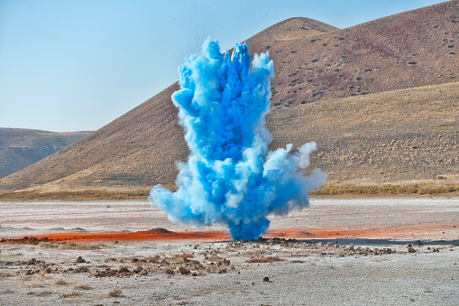 Sportsperson「Colorful blue smoke bombs action in showing」:スマホ壁紙(15)