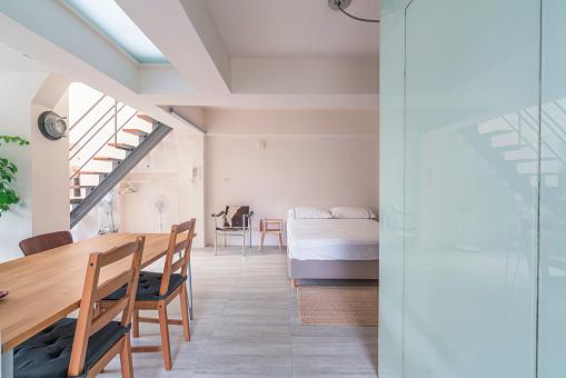 Motel「Open space interior with a bedroom corner」:スマホ壁紙(0)