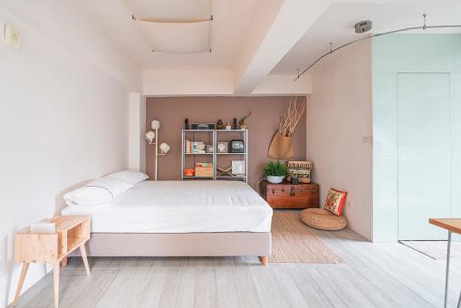 Motel「Open space interior with a bedroom corner」:スマホ壁紙(10)