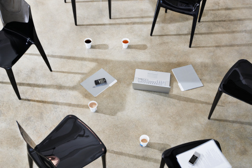 Brainstorming「Six empty chairs indoors around a laptop and folders」:スマホ壁紙(12)
