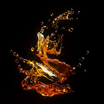 Splashing Droplet「Whiskey liquid splash on black background」:スマホ壁紙(6)