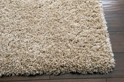 Wool「A cream rug on a dark wooden floor」:スマホ壁紙(11)