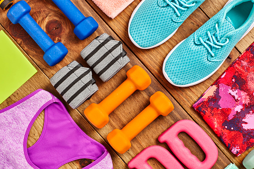 Side By Side「Flat Lay - sports equipment arranged on hardwood floor」:スマホ壁紙(4)