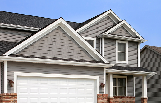 Siding - Building Feature「New home construction, showing siding, roofing, gutters, garage door」:スマホ壁紙(17)