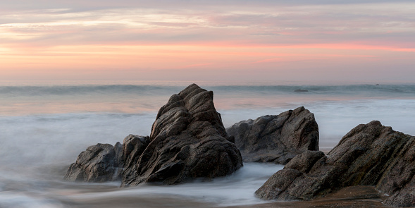 Sayulita「Mist surrounding rocks in the ocean at the coast at sunset; sayulita mexico」:スマホ壁紙(6)