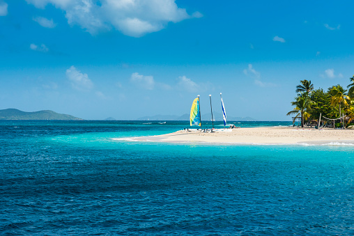 Grenadines「Catamarans moored at white sand beach against sky on Palm island, Grenadines islands, St. Vincent and the Grenadines, Caribbean」:スマホ壁紙(7)