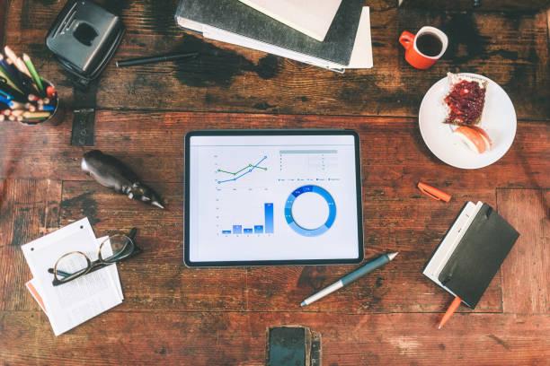 business stats on digital tablet on rustic wooden table:スマホ壁紙(壁紙.com)