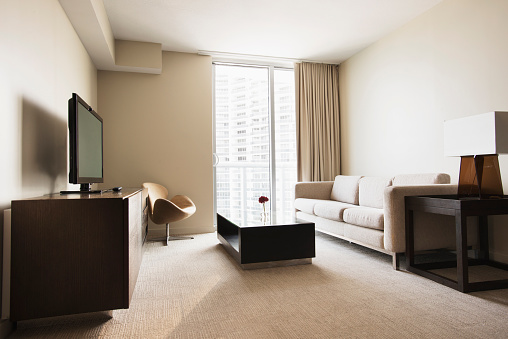 Hotel Room「Sofa, coffee table and television in modern hotel room」:スマホ壁紙(3)