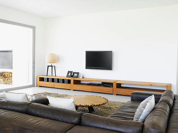 Sofa and television in living room of modern home:スマホ壁紙(壁紙.com)