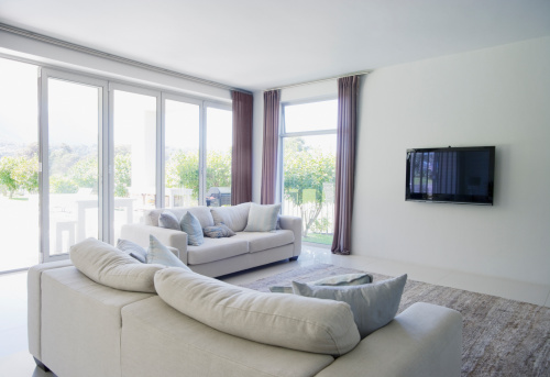 Window「Sofa and television in living room of modern home」:スマホ壁紙(11)