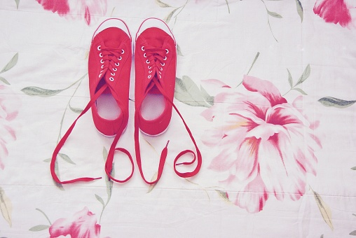 Valentine's Day「Red sneakers with shoelaces spelling the word love」:スマホ壁紙(16)
