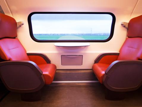 Train Interior「Empty train seats as scenery goes by」:スマホ壁紙(4)
