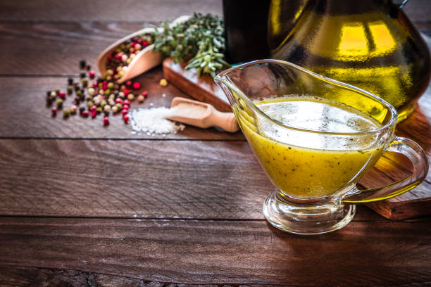 Vinaigrette dressing with copy space on a rustic wooden table:スマホ壁紙(壁紙.com)