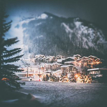 Snowing「Val d'isere french ski resort illuminated village by snowy night in European Alps in winter」:スマホ壁紙(12)