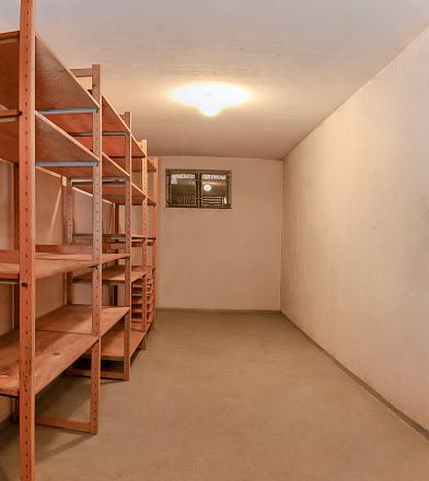 Storage Compartment「Empty basement room wooden storage shelve illuminated ceiling lamp」:スマホ壁紙(10)