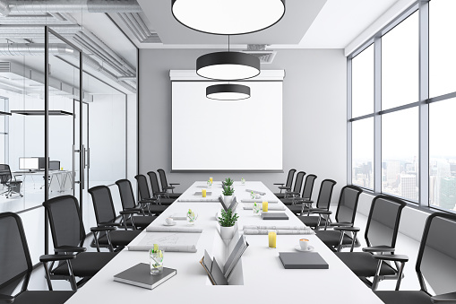Finance and Economy「Contemporary conference room interior with large blank projection screen」:スマホ壁紙(8)
