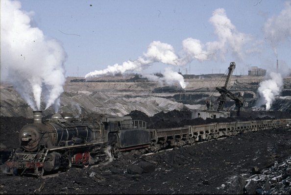Open-pit Mine「The vast opencast coal mine at Manzhouli in Inner Mongolia on the Russian border in north east China. The coal and spoil is bought out by steam trains and the tracks slewed to follow the working of huge diggers. A fleet of standard SY Class Industrial 2-」:写真・画像(17)[壁紙.com]