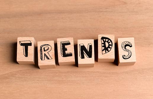 Spelling「Wooden blocks spelling out the word trends」:スマホ壁紙(19)