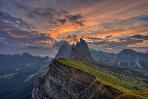 UNESCO「View from the mountain Seceda (Seceda 2519 m ) to the mountains of the Geisler Group (Sass Rigais 3025m) with dramatic clouds at sunrise. UNESCO World Heritage Site.」:スマホ壁紙(5)