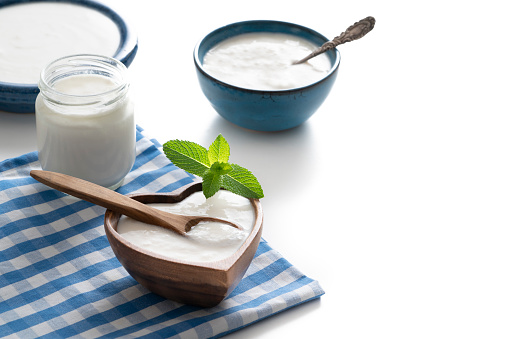 Mint Leaf - Culinary「Homemade yogurt heart shape wooden bowl with mint leaves and glass container isolated on white」:スマホ壁紙(16)