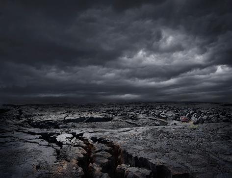 Volcano「Storm clouds over dry rocky landscape」:スマホ壁紙(3)