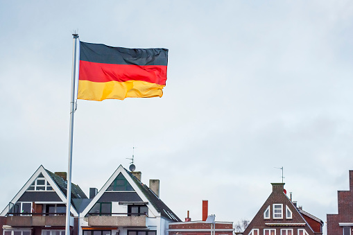 Pole「German flag and rooftops, Travemunde, Lubeck, Germany」:スマホ壁紙(1)