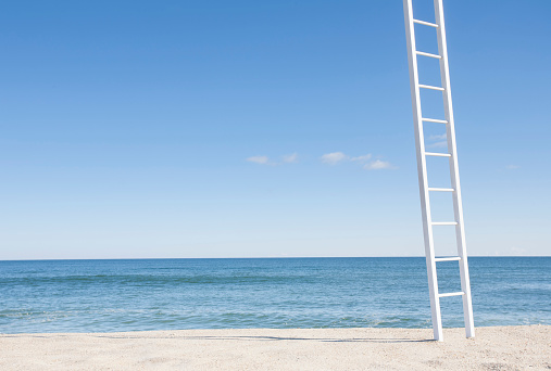 Remote Location「White ladder on empty beach with blue ocean in background」:スマホ壁紙(15)